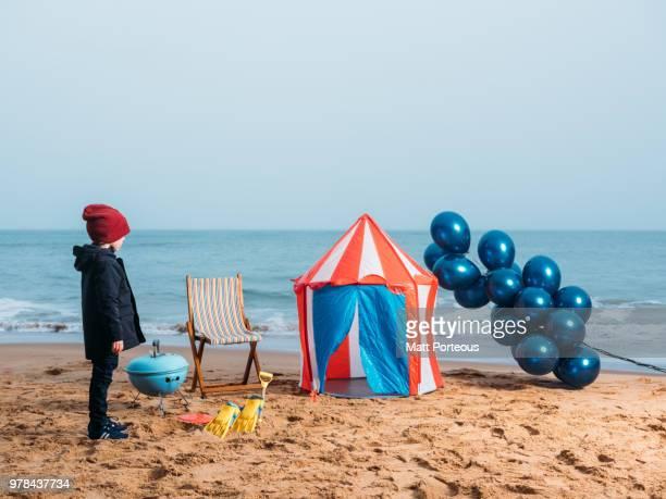 Boy on beach winter beach
