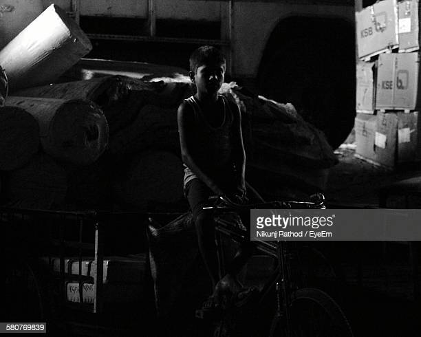 Boy On Bicycle Loaded With Luggage
