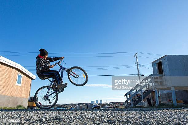 Boy on Bicycle, Whale Cove, Hudson Bay, Nunavut, Canada