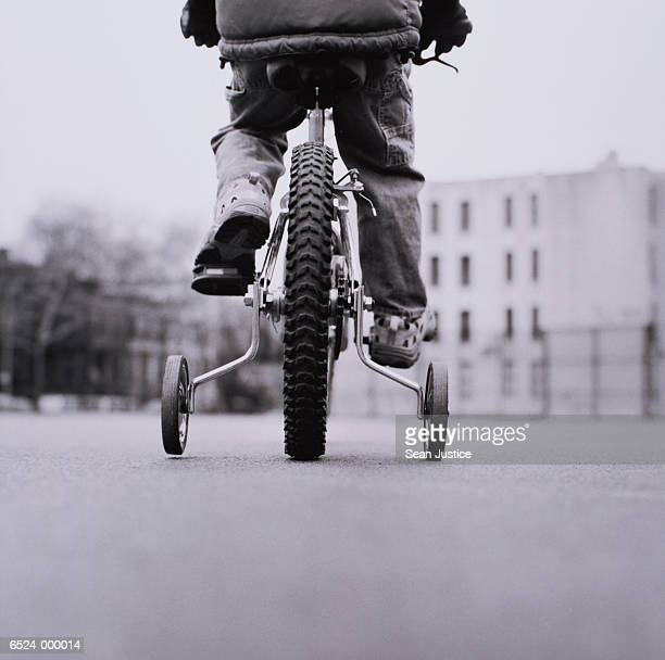 Boy on Bicycle with Stabilizer