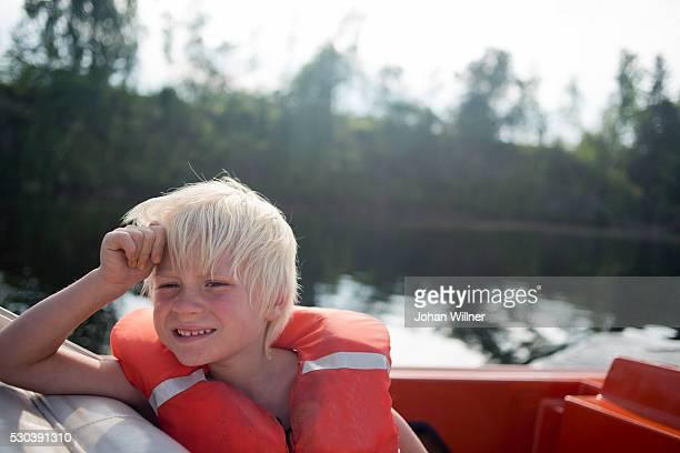 boy on boat, siljan, dalarna, sweden - レクサンド ストックフォトと画像