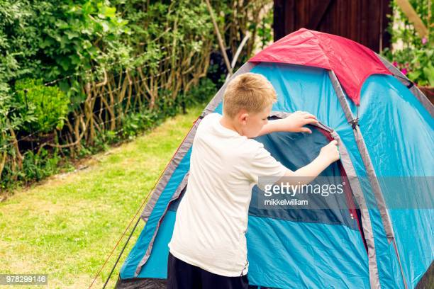 Boy on camping trip sets up a tent for the night all by himself