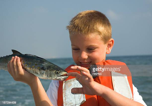 boy on charter fishing boat ,spanish mackerel bite - mackerel stock pictures, royalty-free photos & images