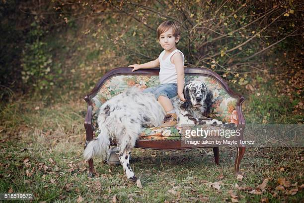 boy on dog - innocence stock pictures, royalty-free photos & images