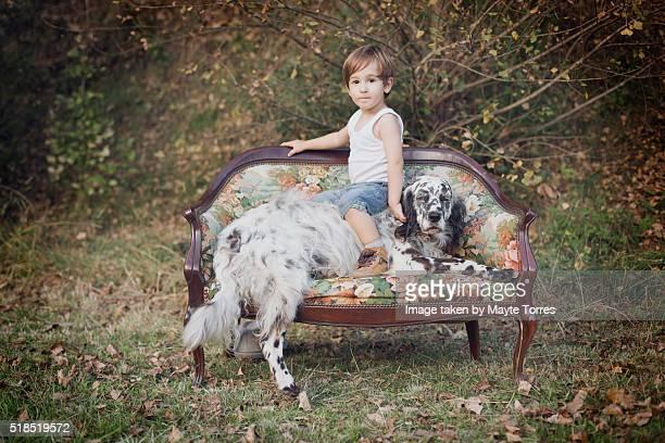 boy on dog - onschuld stockfoto's en -beelden