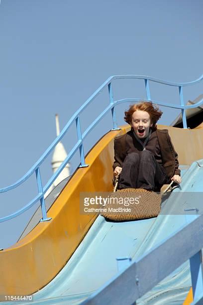 Boy on fairground slide