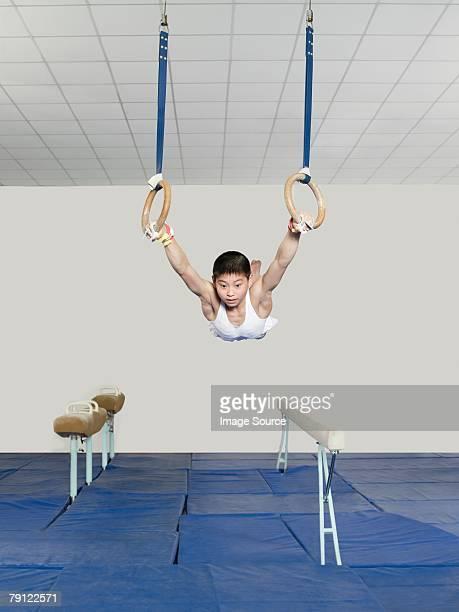 Boy on gymnastic rings