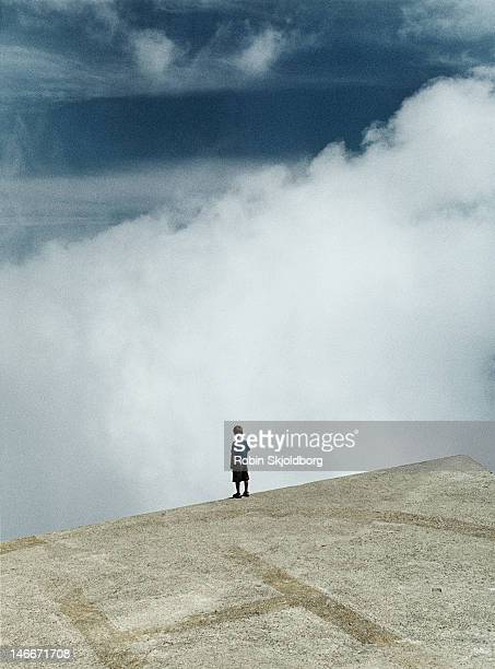 boy on hellicopter platform looking out - livorno stock pictures, royalty-free photos & images