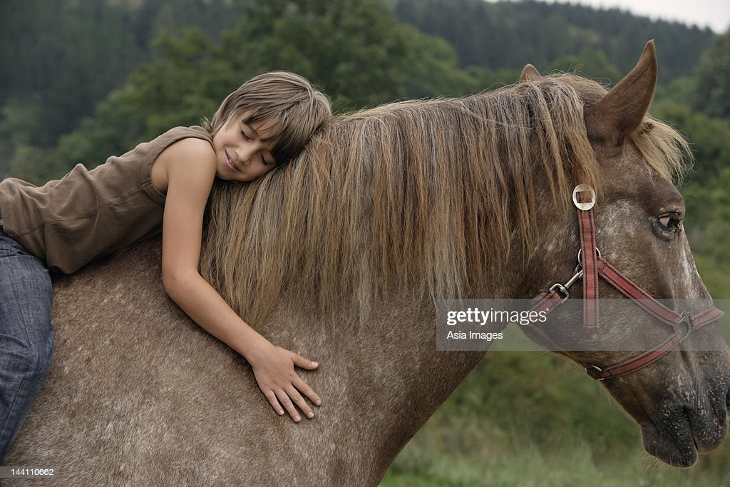 Boy On Horseback High Res Stock Photo Getty Images