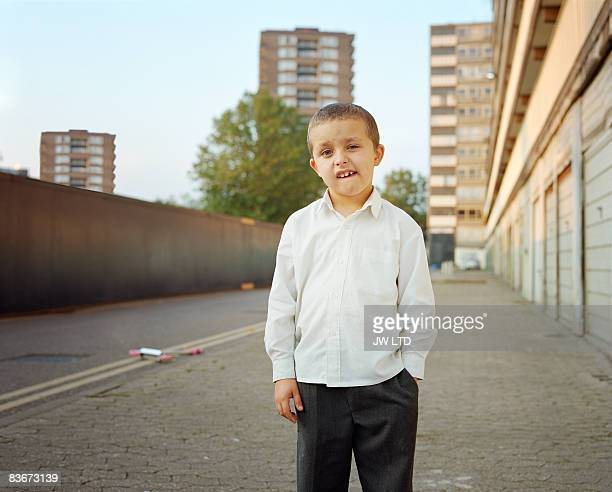 Boy on housing estate, portrait