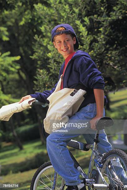 Boy on newspaper delivery route