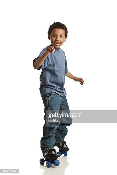 boy on roller skates - roller skating stock pictures, royalty-free photos & images