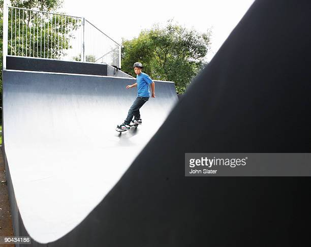 boy on skate board on half-pipe - half pipe stock pictures, royalty-free photos & images