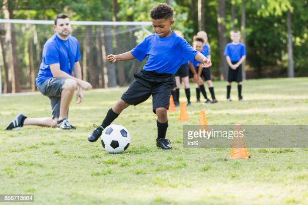 boy on soccer team practicing - childhood stock pictures, royalty-free photos & images