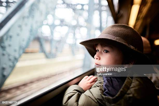 Boy On Subway Looking Out Window.