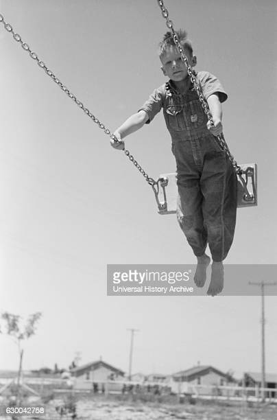 Boy on Swing Farm Security Administration Labor Camp Caldwell Idaho USA Russell Lee June 1941