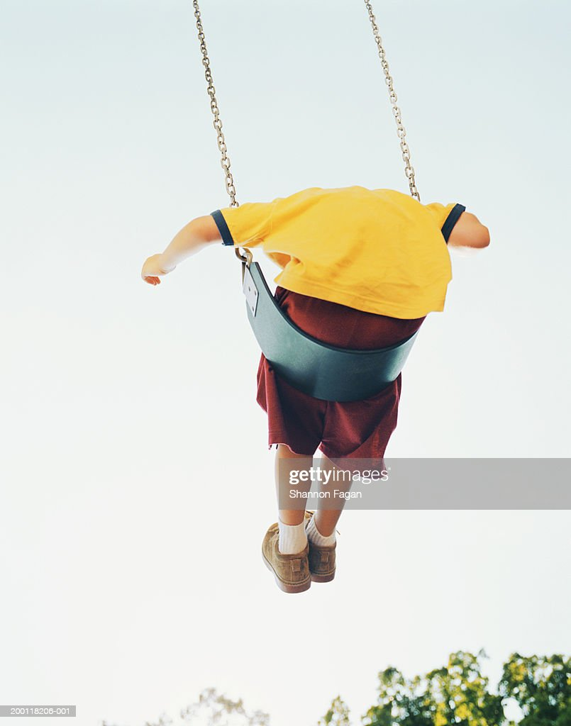 Boy On Swing Rear View Low Angle Stock Photo Getty Images Harness 8 10