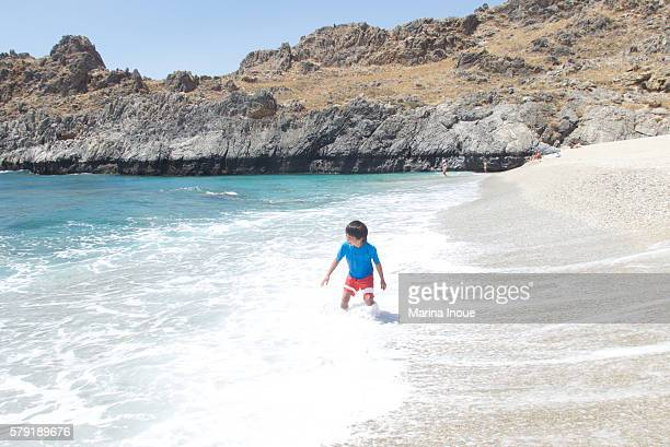 a boy on the beach - inoue stock photos and pictures
