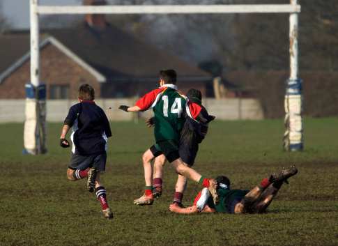 Boy on the ground in a rugby game 172262496