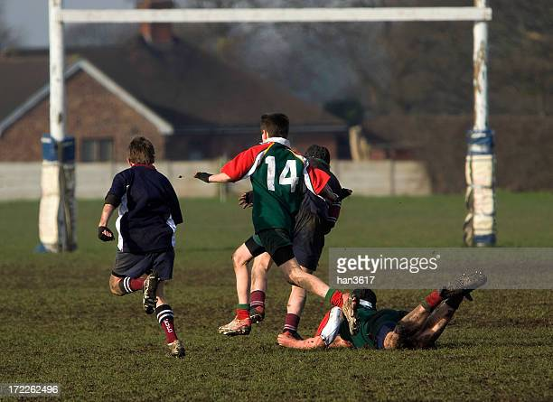 boy on the ground in a rugby game - rugby stock pictures, royalty-free photos & images