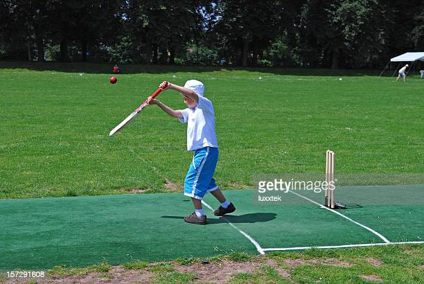 boy on the pitch - wicket stock pictures, royalty-free photos & images