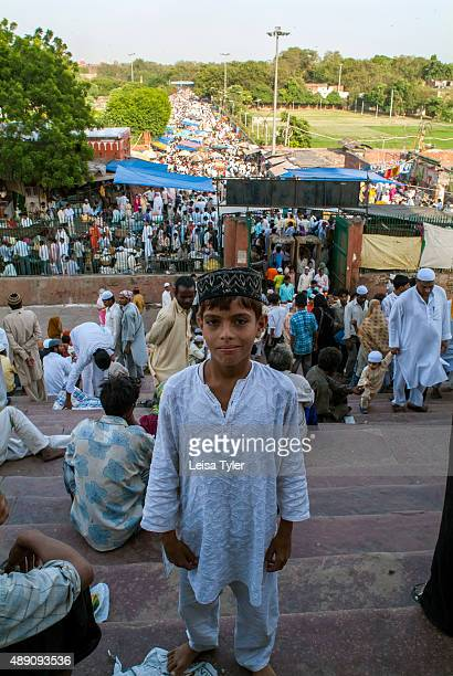 A boy on the stairway in front of Delhi's Jama Masjid during Friday prayers