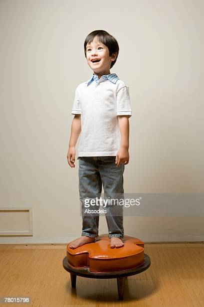 a boy on the stool - 4歳から5歳 ストックフォトと画像