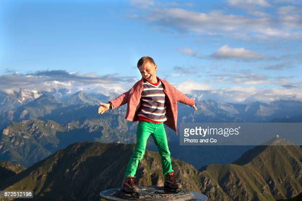 boy on top of peak