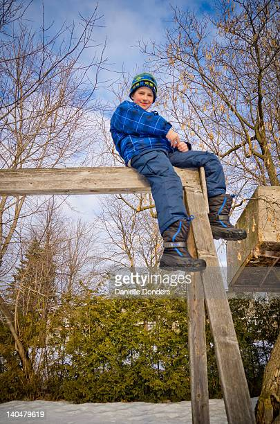 Boy on top of play structure
