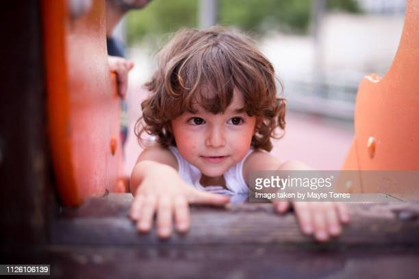 boy on top of the slide - zakenman stock pictures, royalty-free photos & images