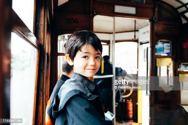 Boy on tram