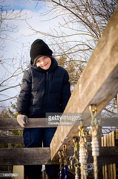 Boy on wooden play structure