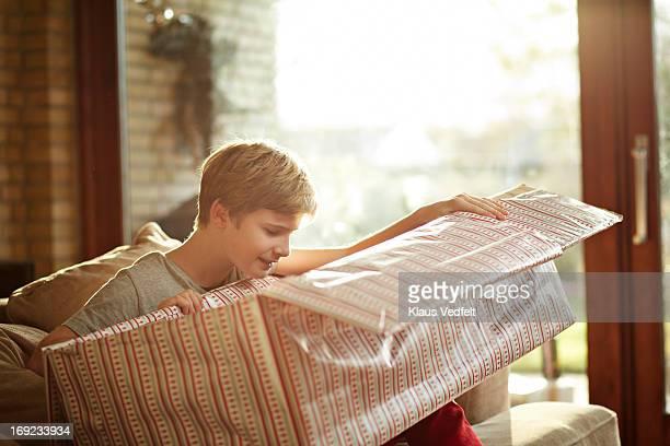 Boy opening big christmas present