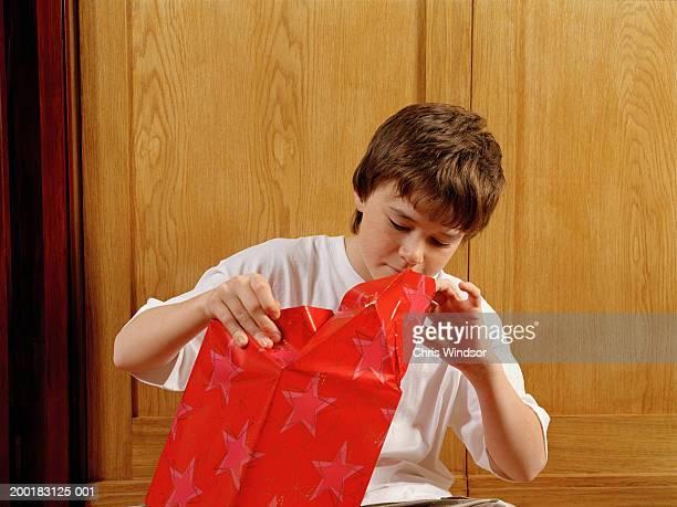 Boy (12-14) opening present