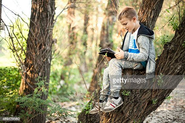 Boy outdoors with a digital tablet digital tablet
