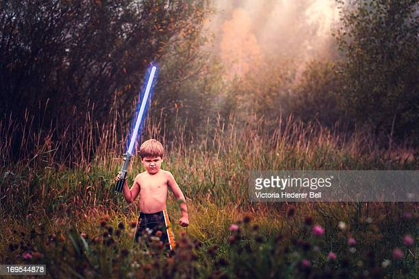Boy Outdoors with Glowing Light Saber