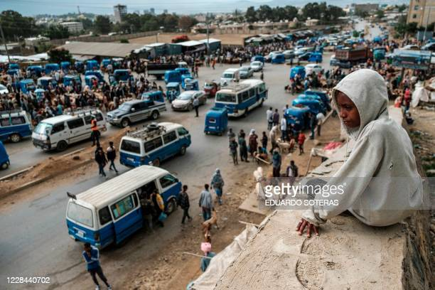 Boy overlooks a flock markets during the preparations for the eve of the Ethiopian New Year, in the city of Mekele, Ethiopia, on September 10, 2020....