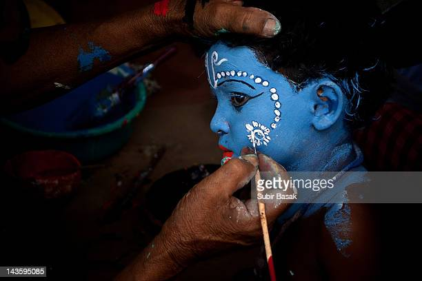 Boy painted his face like Lord Krishna