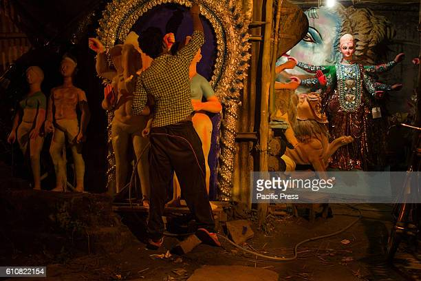 A boy painting idols With Durga Puja round the corner preparations are in full swingDurga Puja is the most important festival of Hindus Bengal...