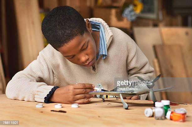 Boy Painting Model Airplane