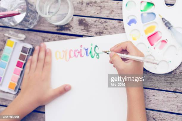 Boy painting with watercolor paints