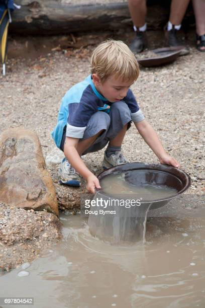 Boy panning for gold