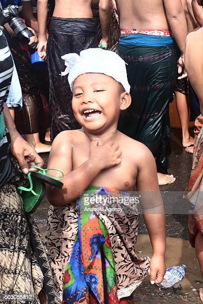 A boy participates the water war festival callled Siat Yeh at Suwat village on January 01 2016 in Gianyar Bali Province Indonesia Water war for the...