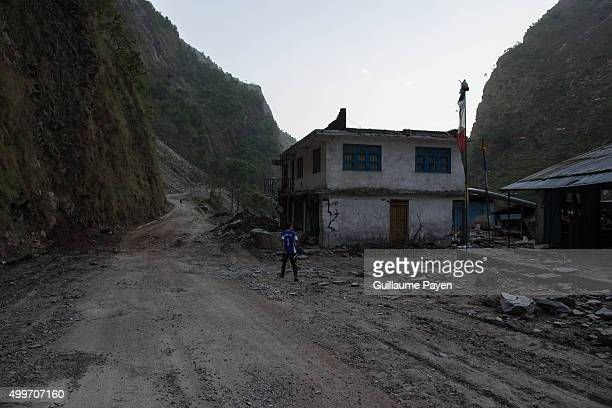 A boy pass through a destroyed village abandoned by people on the Araniko Road near the Kobani Village Isolated Nepalese Villagers still waiting for...