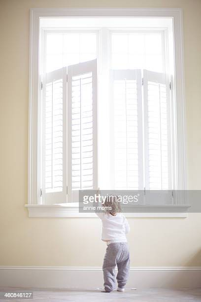 Boy peeking out window