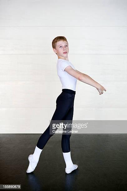Boy performing ballet poses