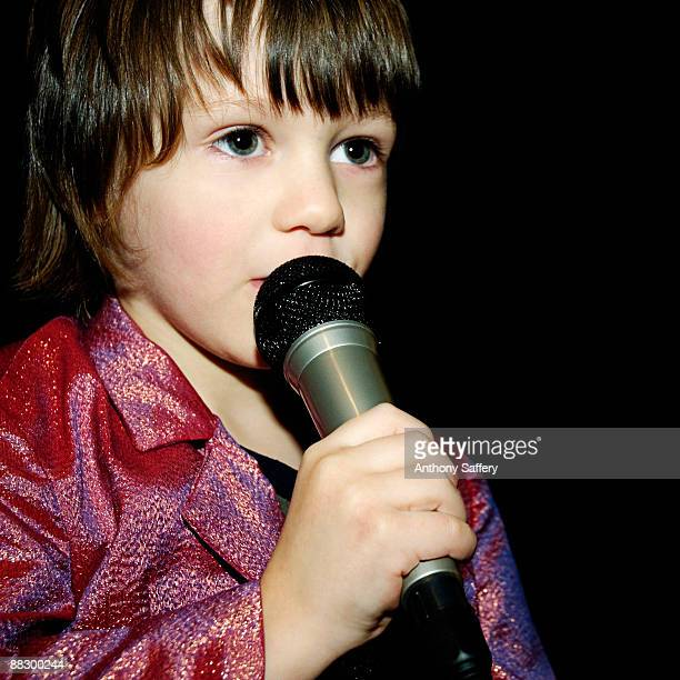 Boy performing with microphone