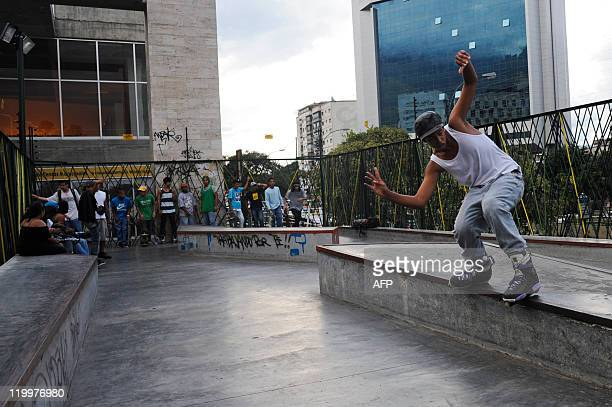 A boy performs a railtrick on his rollerblades at a public skatepark in Caracas on July 27 2011 AFP PHOTO / Leo RAMIREZ
