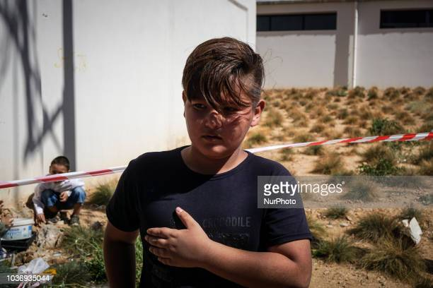 A boy performs during the procession for the annual commemoration Ashura in Pireaus 20 September 2018 Hundreds of Shiite Muslims gathered in Piraeus...