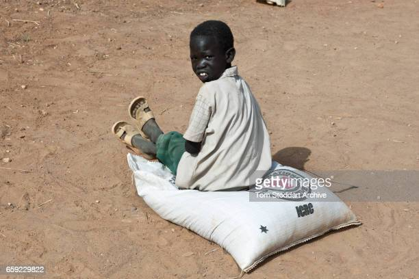 A boy photographed in Abathok village during an International Committee of the Red Cross distribution of seeds agricultural tools and food staples to...
